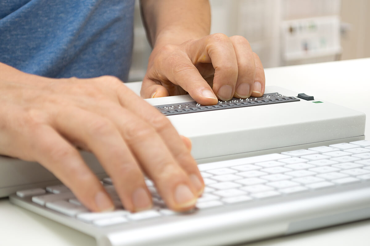 A visually impaired person using a braille display.